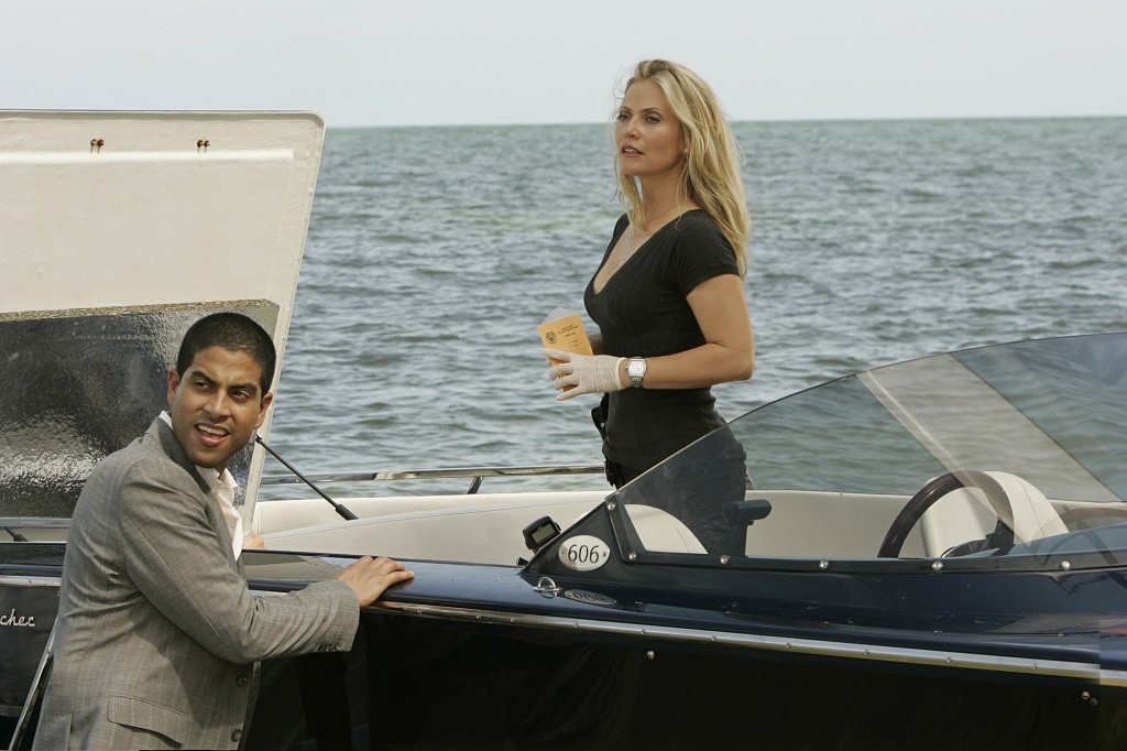 """DANGEROUS SON""--A hostage situation turns into murder when a probation officer is gunned down, leading Horatio to believe one of the suspects may be his son, on the sixth season premiere of CSI: MIAMI, Monday, Sept. 24 (10:00-11:00 PM, ET/PT) on the CBS Television Network. Pictured: Eric Delko (Adam Rodriguez) and Calleigh Duquesne (Emily Procter). Photo: Cliff Lipson/CBS ©2007 CBS Broadcasting Inc. All Rights Reserved."