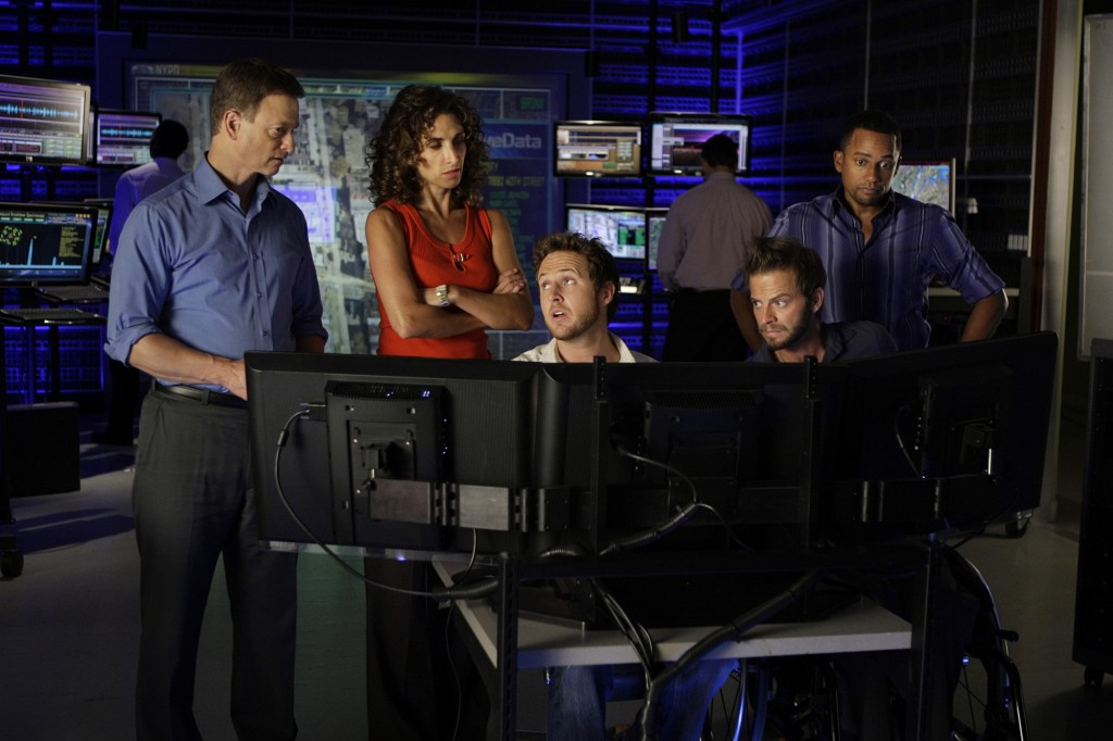 """Blacklist Featuring Grave Digger"" -- When Det. Mac Taylor (Gary Sinise), Det. Stella Bonasera, (Melina Kanakaredes), Adam Ross (AJ Buckley), Danny Messer (Carmine Giovinazzo) and Dr. Sheldon Hawkes (Hill Harper) investigate a case of a cyber killer, it turns personal when the suspect invokes the name of Mac's father who had died nearly two decades earlier, on CSI: NY, Wednesdays, (10:00-11:00 PM, ET/PT) on the CBS Television Network. Photo: Cliff Lipson/CBS ©2009 CBS Broadcasting Inc. All Rights Reserved."