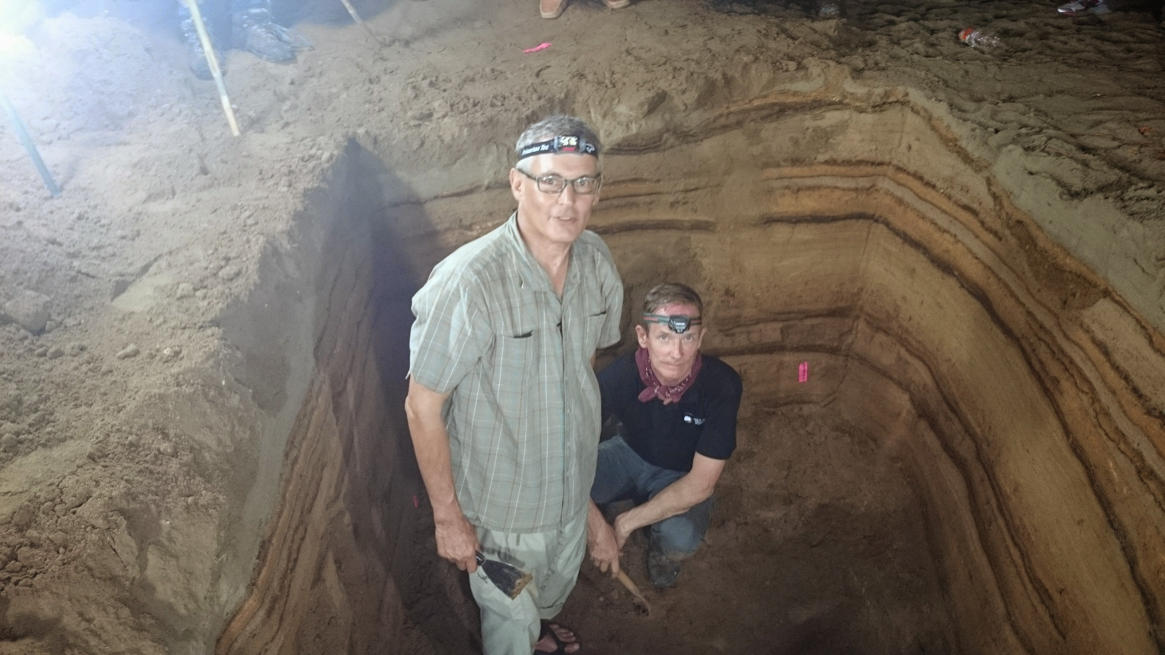 Banda Aceh, Indonesia - Professors Charles Rubin and Kerry Sieh stad inside a hole dug to expose the tsunami sediments.